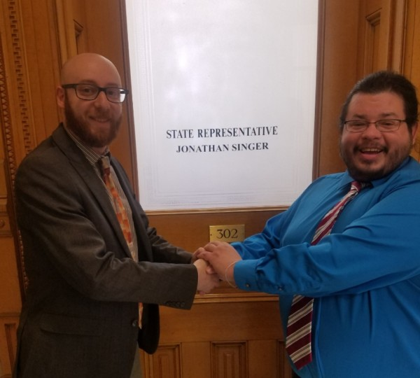 Rico Dence, Founder of Team Up Cancer. meets with  Colorado State Representative Jonathan Singer.